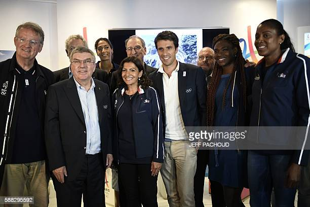 IOC President Thomas Bach poses with Paris Mayor Anne Hidalgo French former athletes Tony Estanguet 3R Muriel Hurtis and MarieJose Perec at the Club...
