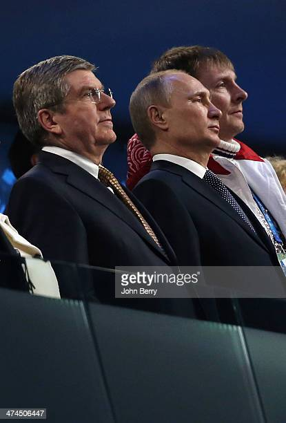 President Thomas Bach President of Russia Vladimir Putin and double gold medalist bobsleigh pilot Alexander Zubkov look on during the 2014 Sochi...