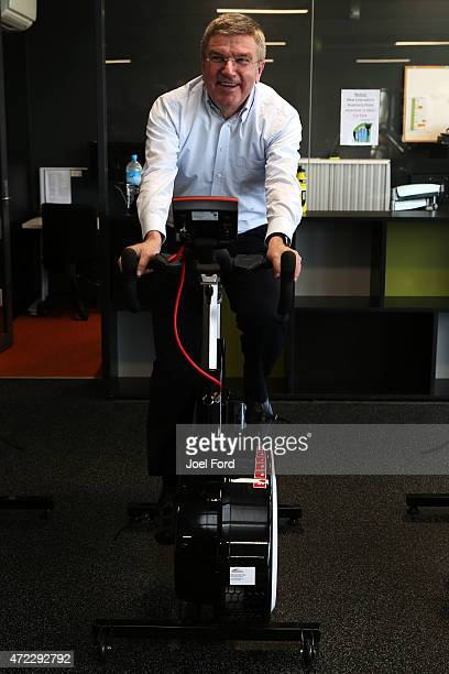 President Thomas Bach rides a stationary bike during a visit to the Avantidrome on May 6 2015 in Cambridge New Zealand