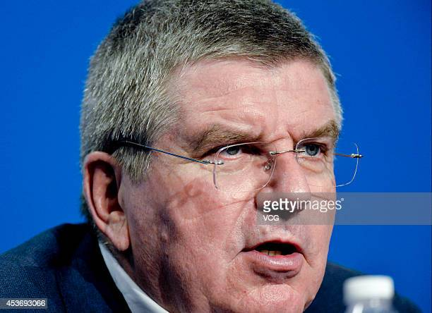 IOC President Thomas Bach speaks during a press conference for awarding the winner of the official medal design competition for the Nanjing 2014...