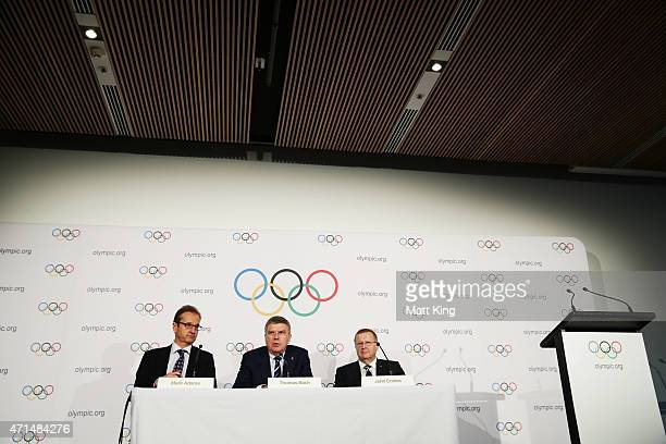 President Thomas Bach speaks to the media at a press conference next to IOC Director of Communications Mark Adams and AOC President John Coates at...