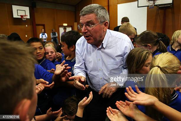 President Thomas Bach speaks with with students during a visit to Leamington Primary School on May 6 2015 in Cambridge New Zealand
