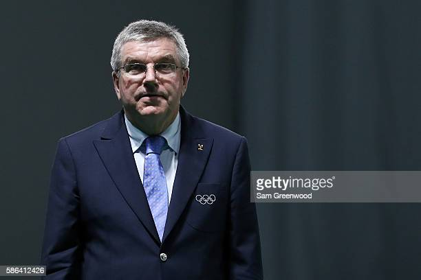 President Thomas Bach stands during the medal presentation for the Women's 10m Air Rifle on Day 1 of the Rio 2016 Olympic Games at the Olympic...