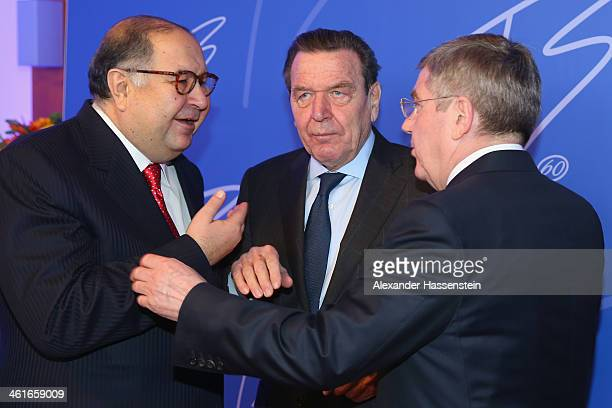 President Thomas Bach talk to former German Chancellor Gerhard Schroeder and Alisher Usmanov President of the International Fencing Federation during...