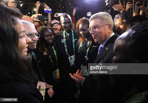 President Thomas Bach talks to athletes of the Refugee Olympic Athletes during the Team Welcome Ceremony for the Refugee Olympic Team at Olympic...