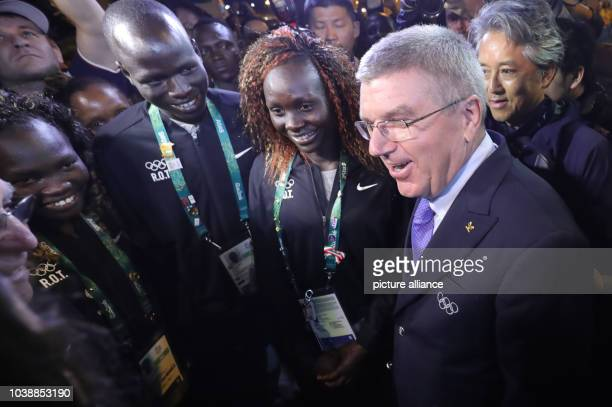 President Thomas Bach talks to Chef de Mission for Olympic Refugees team, Tegla Loroupe of Kenya, Yiech Pur Biel and Anjelina Nada Lohalith both from...