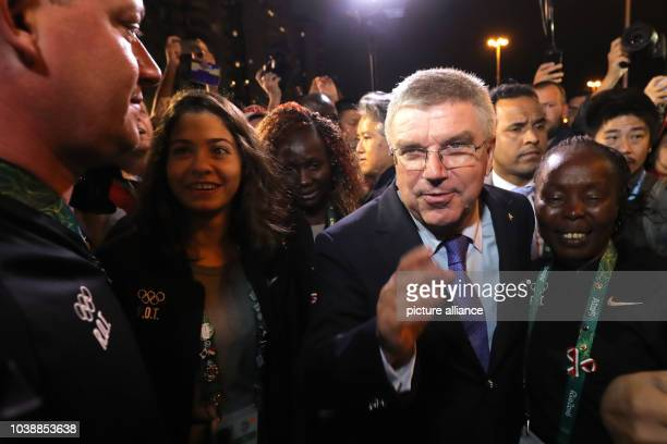 President Thomas Bach talks to Swimmer Yusra Mardini of the Refugee Olympic Athletes and Chef de Mission for Olympics Refugees, Tegla Loroupe of...