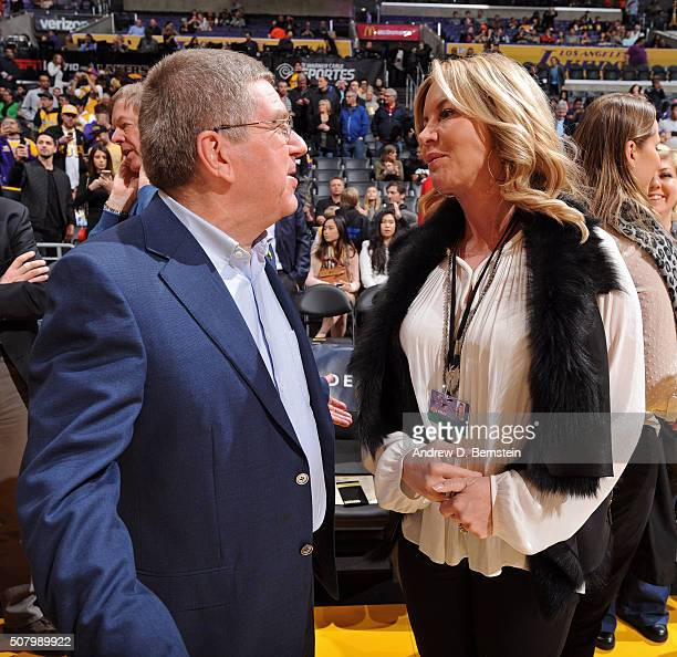 President Thomas Bach talks with Los Angeles Lakers part owner Jeanie Buss before the Charlotte Hornets game at STAPLES Center on January 31 2016 in...