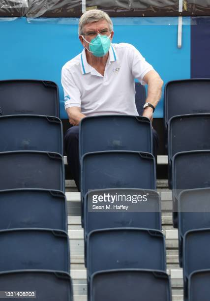President Thomas Bach watches the game between Team Australia and Team ROC during the Women's Preliminary - Pool E beach volleyball on day seven of...