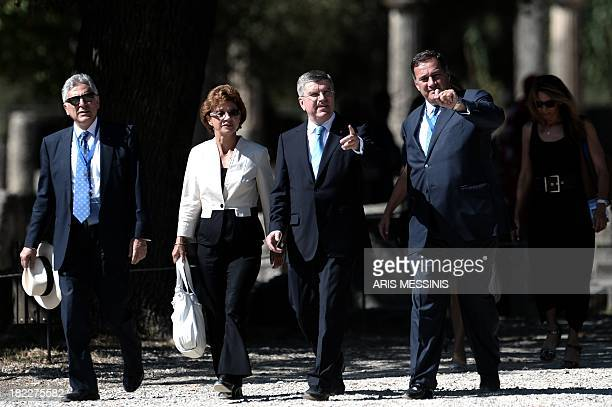IOC president Thomas Bach with his wife arrive at ancient Olympia on September 29 2013 during the Olympic Flame lighting ceremony in ancient Olympia...