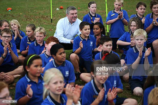 President Thomas Bach with students during a visit to Leamington Primary School on May 6 2015 in Cambridge New Zealand
