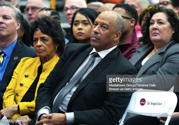 President Thomas Parham listens as Dr Angela Davis speaks to students and community members in the packed gymnasium at CSU Dominguez Hills in Carson...
