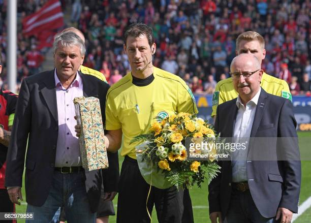 President Thomas Schmidt and former Referee and Member of DFBSchiedsrichterKommission KarlHeinz Tritschler honours Referee Wolfgang Stark for new...