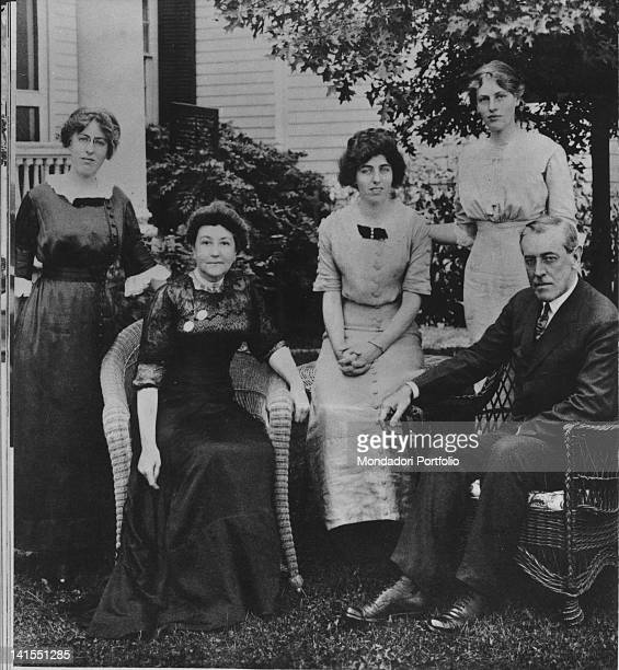 US President Thomas Woodrow Wilson sitting in his garden with his wife Ellen Louise Axson and his daughters Margaret Woodrow Wilson Eleonor Randolph...
