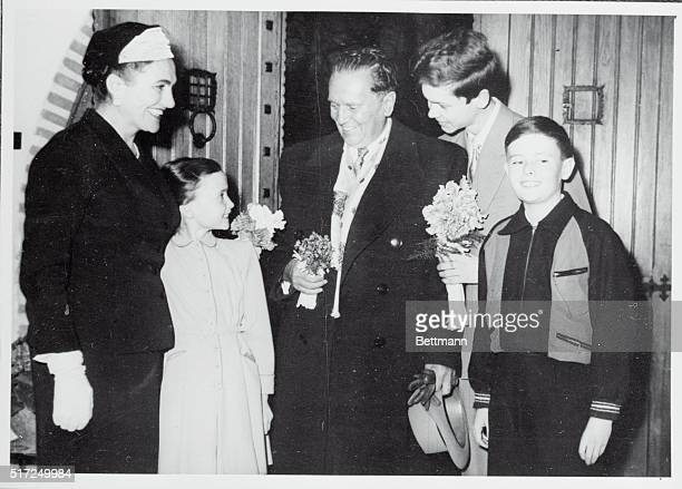 President Tito of Yugoslavia and Mme Jovanka Broz are welcomed by the President's son Misha and grandchildren Zlatica and Joze upon arrival home from...