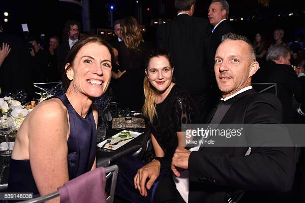 President TNT/TBS productions and business affairs Sandra Dewey with Turner actress Drew Barrymore and producer Chris Miller pose backstage at the...