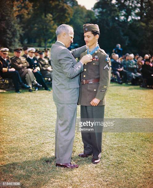 President Truman awarding Congressional Medal of Honor to Corporal Desmond Doss of Lynchburg Va a conscientious objector who served in Medical Corps