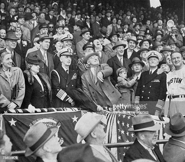 President Truman throws out the first ball of the 1949 season in Griffith Stadium in Washington in April. Boston's manager Joe Cronin is at far right.