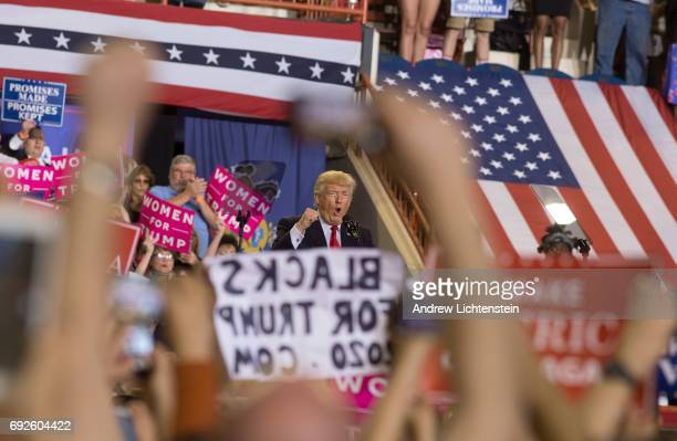 President Trump addresses an enthusiastic crowd of supporters at a rally on April 29 2017 in Harrisburg Pennsylvania President Trump celebrated his...