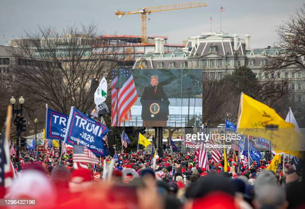 """President Trump speaks from a Jumbotron screen as crowds gather for the """"Stop the Steal"""" rally on January 06, 2021 in Washington, DC. Trump..."""
