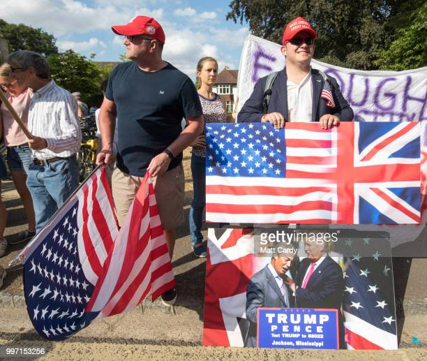 President Trump supporters join protestors gathering at the gates of Blenheim Palace where US President Donald Trump is due to visit for diner in...