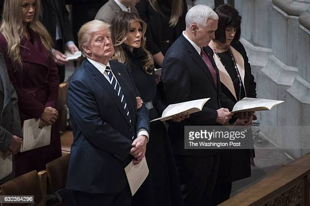 President Trump with first lady Melania Trump Vice President Mike Pence and his wife Karen Pence listen during the National Prayer Service at the...