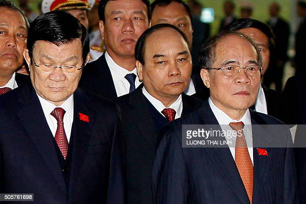 President Truong Tan Sang Deputy Prime Ministers of Vietnam Nguyen Xuan Phuc and National Assembly Chairman Nguyen Sinh Hung attend a wreath laying...