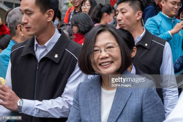 President Tsai Ingwen leaves after distributing red envelopes during the celebration in New Taipei CityPresident Tsai Ingwen visited the Yonglian...