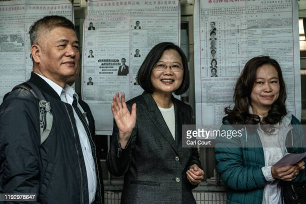 President Tsai Ing-wen of Taiwan waves while on a queue to vote in the presidential election on January 11, 2020 in Taipei, Taiwan. Taiwan will go to...