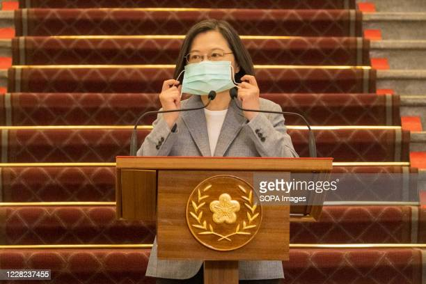 President Tsai Ing-wen wears a face mask as a preventive measure during a press conference at the presidential palace. Taiwan President Tsai Ing-wen...
