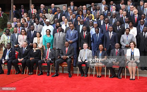 President Uhuru Kenyatta has a word with delegates attending the 39th session of the African Caribbean and Pacific European Union council of...