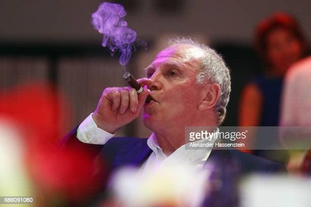 President Uli Hoeness smokes a cigar during the FC Bayern Muenchen Championship party following the Bundesliga match between Bayern Muenchen and SC...