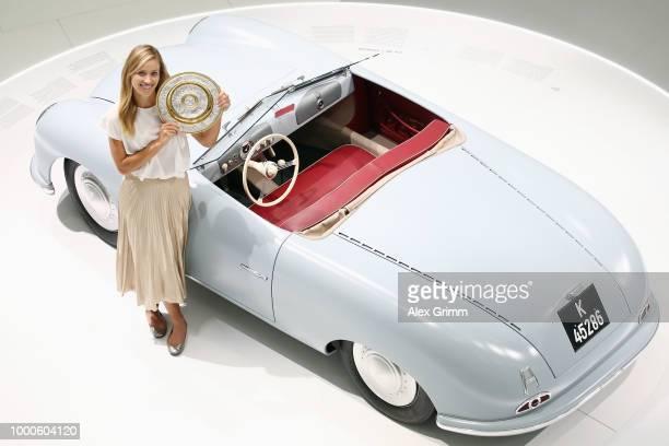 President Ulrich Klaus congratulates Porsche Brand Ambassador and Wimbledon champion Angelique Kerber during a press conferendce at the Porsche...