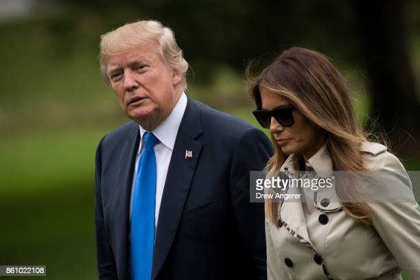 President US President Donald Trump and first lady Melania Trump exit Marine One on the South Lawn of the White House October 13 2017 in Washington...