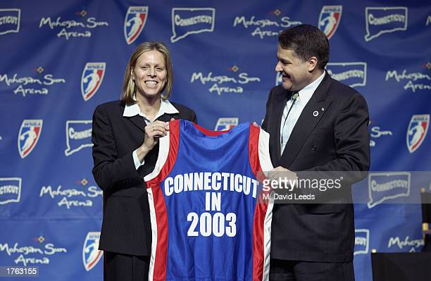 President Val Ackerman presents a commemorative WNBA jersey to Mark Brown chairman of the Mohegan Tribe at a press conference introducing the WNBA's...