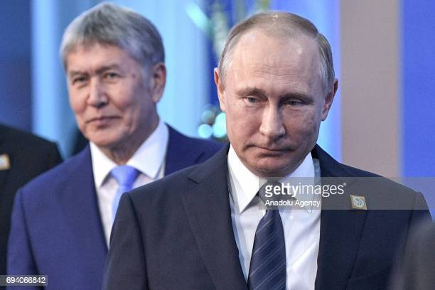 President Vladimir Putin and Kyrgyzstan's President Almazbek Atambayev are seen ahead of a meeting of the Shanghai Cooperation Organisation Heads of...