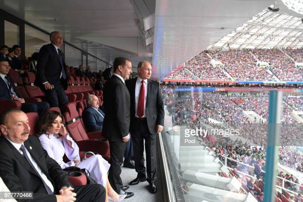 President Vladimir Putin and Prime Minister Dmitry Medvedev attend the opening ceremony prior to the 2018 FIFA World Cup Russia Group A match between...