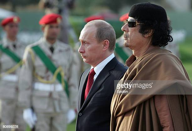President Vladimir Putin of Russia meets with Libyan leader Muammar Qadaffi on April 16 2008 in Tripoli Libya Putin is in Libya for a twoday official...