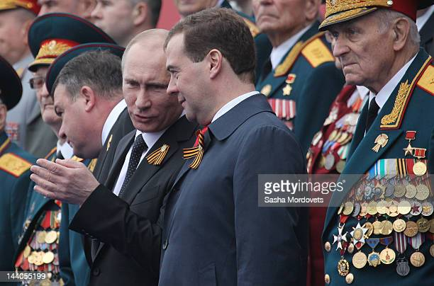 President Vladimir Putin speaks to Prime Minister Dmitry Medvedev during the Victory Day Parade at Red Square on May 9 2012 in Moscow Russia Over...