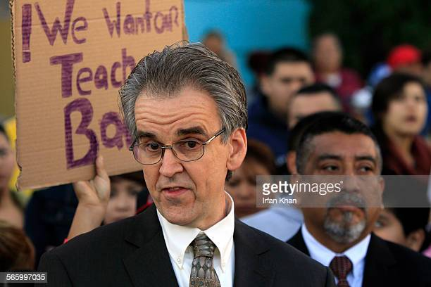 UTLA president Warren Fletcher holds a news conference in front of Miramonte Elementary in South Los Angeles Thursday morning as LAUSD replced the...