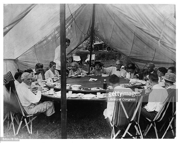 President Warren G Harding has lunch in a tent with Thomas Edison and Henry Ford