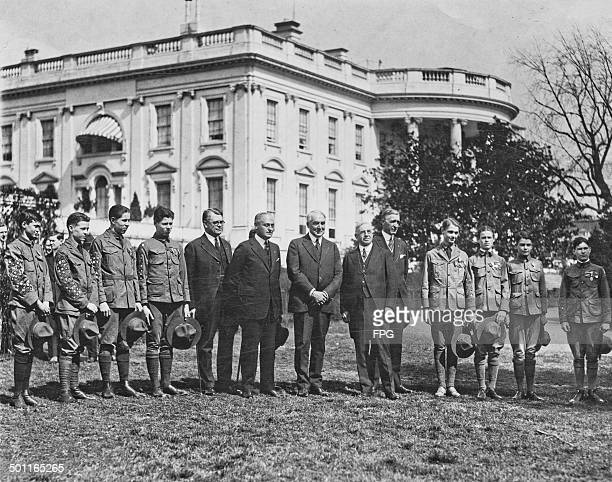 US President Warren G Harding receives a group of Eagle Boy Scouts at the White House Washington DC 16th March 1921 The President is being awarded...