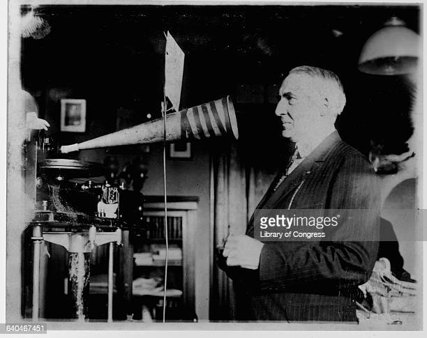 President Warren G Harding recording with a soundcatching megaphone attached to gramaphonerecording machine in 1922