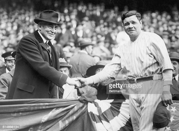 President Warren G Harding shakes hands with New York Yankee player Babe Ruth during an April 4 1923 visit to Yankee Stadium