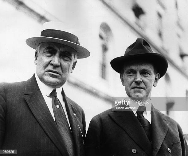 US president Warren G Harding stands outdoors with Vice President Calvin Coolidge