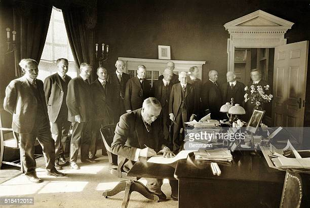 President Warren Harding is surrounded by lawmakers as he signs the 1922 ClapperVolsted act The act allowed farmers and agricultural producers to...