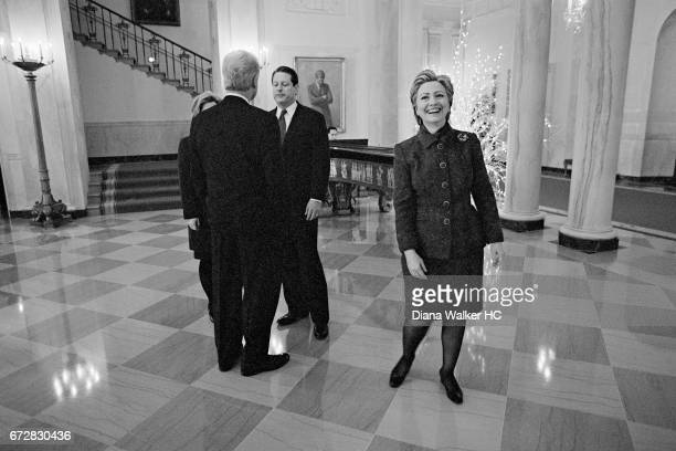 President William Clinton First Lady Hillary Rodham Clinton and Vice President Al Gore are photographed awaiting the arrival of Presidentelect on...