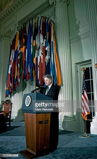 President William Clinton holds an informal press conference after signing the legislation authorizing the United States to join the GATT trade...