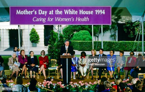 President William Jefferson Clinton addresses the Women's Health Care meeting on the South Lawn of the White House under a banner that says Mother's...