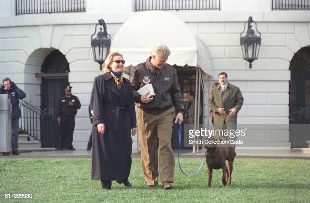 President William Jefferson Clinton and First Lady Hillary Rodham Clinton with Buddy the Dog en route to Marine One March 3 1998 Image courtesy...